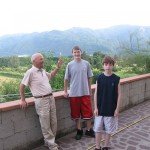 My cousin Anna's husband, Edmundo, with my two boys in Filecchio, the small village where my father was born. The view is from my cousin's back terrace. (Photo by Mark Micheli)